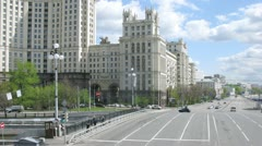 Cars go on Kotelnichesky Avenue near Stalin skyscraper Stock Footage