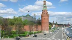 Vodovzvodnaya tower stands against Kremlin palace, time lapse Stock Footage