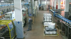 Worker watch on conveyor with cans for drinks at plant Stock Footage