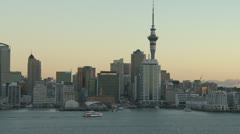 Time lapse of Auckland Harbour and Ferrys as evening sets - stock footage