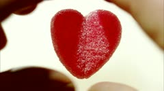 Divided candy heart Stock Footage