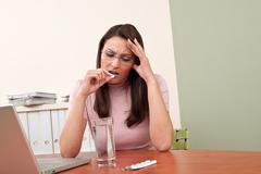 businesswoman with headache take pill - stock photo