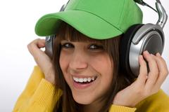 happy female teenager enjoy music - stock photo