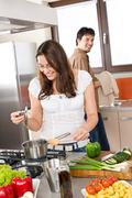Young couple cook in modern kitchen Stock Photos
