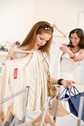 Stock Photo of fashion shopping -  two happy young woman choose clothes
