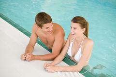 Swimming pool - young cheerful couple have fun Stock Photos