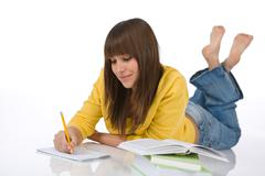 Student - female teenager write homework Stock Photos