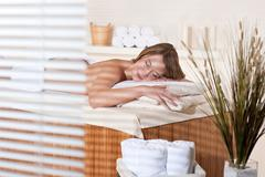 spa - young woman relax at massage treatment - stock photo