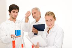 chemistry experiment -  scientists in laboratory - stock photo