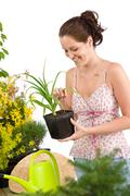 gardening - woman holding flower pot - stock photo