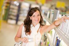 Shopping cosmetics - woman with moisturizer Stock Photos