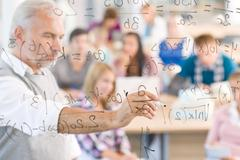 math lesson at high school - students - stock photo
