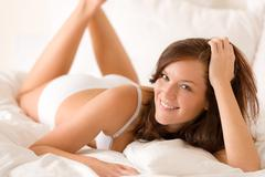 Bedroom - woman lying down in lingerie Stock Photos