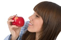 happy teenager eating healthy apple for breakfast - stock photo
