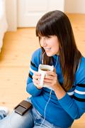 Teenager girl relax home - listen to music Stock Photos