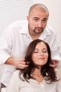 Stock Photo of professional hairdresser comb customer at salon