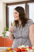 Cook - plus size woman with white wine and vegetable Stock Photos