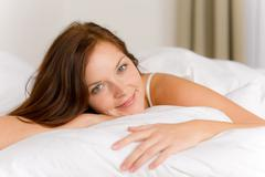 Bedroom - happy woman in bed waking up Stock Photos