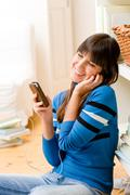 teenager girl relax home - happy listen to music - stock photo