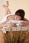 Spa - young female client at wellness massage Stock Photos