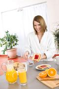 Breakfast - happy woman with toast and marmalade Stock Photos