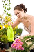 Stock Photo of gardening - woman with watering can and flowers