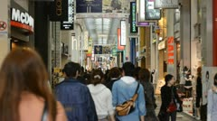 Shoppers People Walk Crowd Pass Famous Brands Shopping Street Asian Store Osaka - stock footage