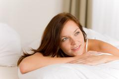 Stock Photo of bedroom - happy woman in white bed
