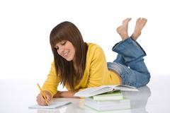 Happy female teenager write homework Stock Photos