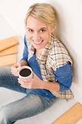home improvement - handywoman coffee break - stock photo