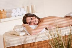 spa - young woman at wellness massage treatment - stock photo