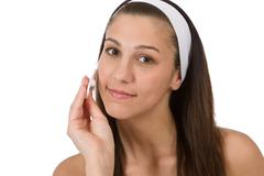Beauty facial care - teenager woman cleaning acne skin Stock Photos