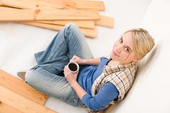 Home improvement - handywoman coffee break Stock Photos