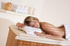 Stock Photo of spa - young woman at wellness massage relaxing