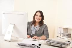young attractive business woman working at office - stock photo