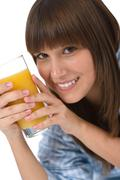Stock Photo of female teenager with healthy orange juice