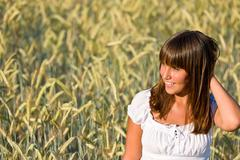 young woman in corn field enjoy sunset - stock photo