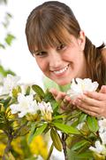 Stock Photo of gardening - portrait of woman with rhododendron flower