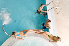 top view - young people relax in swimming pool - stock photo