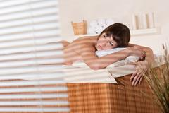 spa - young female client at wellness massage - stock photo
