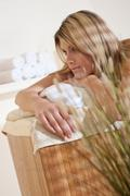 spa - young woman at wellness massage relaxing - stock photo