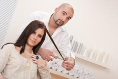 Professional hairdresser cut with scissors at salon Stock Photos