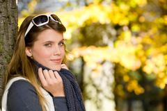 Autumn park - fashion woman with sunglasses Stock Photos