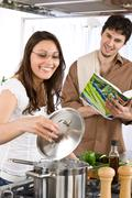 happy couple cook together in modern kitchen - stock photo