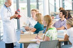 medicine students with professor - stock photo