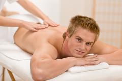 man having luxury back massage - stock photo