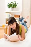 teenager girl relax home - read book - stock photo