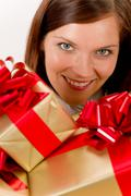 Stock Photo of happy woman holding christmas presents