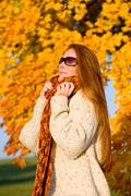 Stock Photo of autumn country sunset - long red hair woman