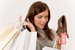 Shopping - woman holding shoes and bags Stock Photos